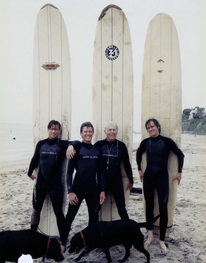 Gesner on beach with his three sons. From Left: Zen, Jake, Gesner and Stepson Dolan