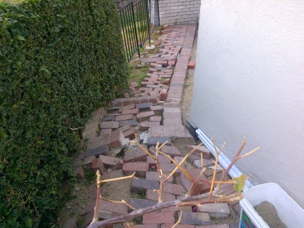 The scattered bricks indicate that this slope has eroded